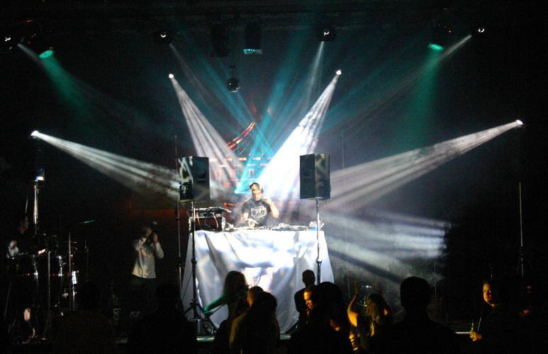 Photo of DJ Carl Cox on stage with intelligent lighting
